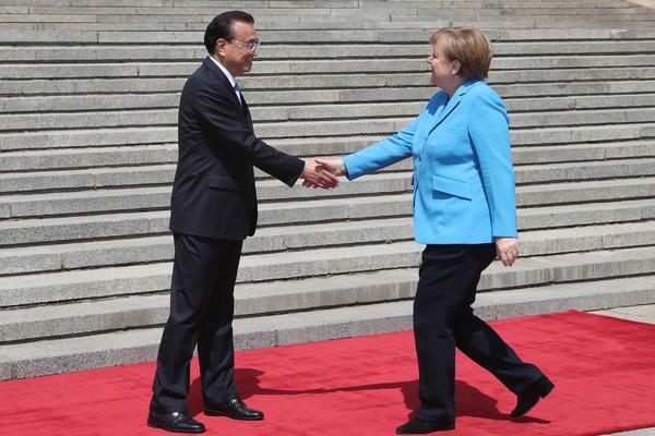Premier Li welcomes German chancellor to Beijing:null