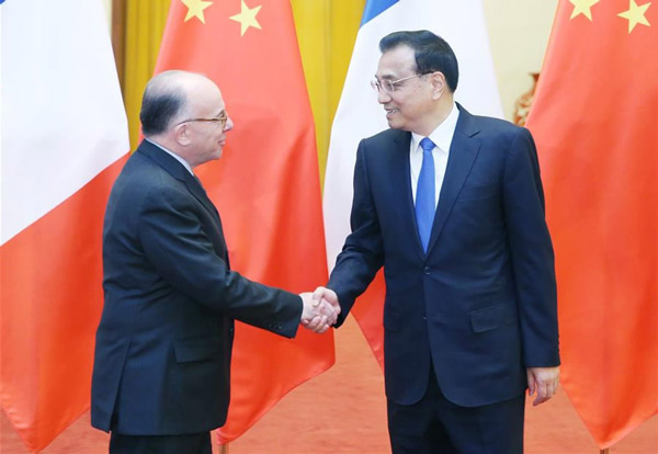 Premier Li meets French PM in Beijing:null