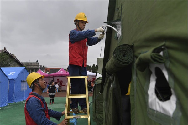Earthquake relief work in progress in Weiyuan county, Sichuan province:null