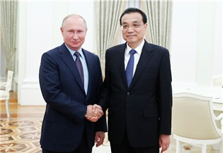 Premier meets Putin on bilateral ties:0