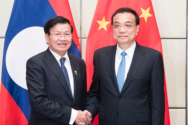 China, Laos eye closer cooperation to build community with shared future:null