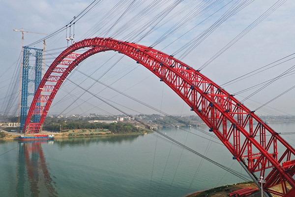 Main arch ribs of Third Pingnan Bridge closes in China's Guangxi:null