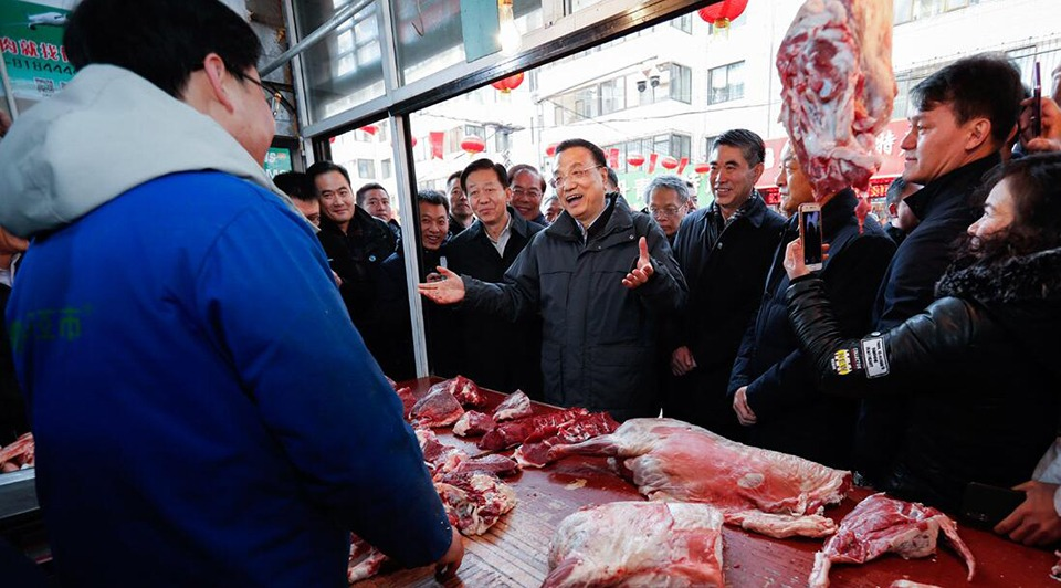 Premier Li presses for stable, affordable meat supplies:0