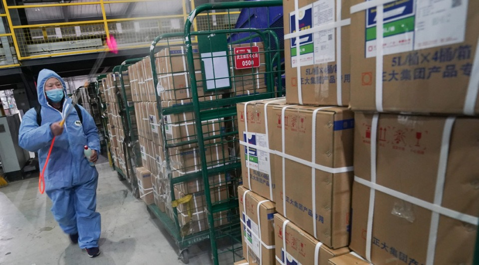 Staff members of post office work overtime to ensure supplies to be delivered on time:2