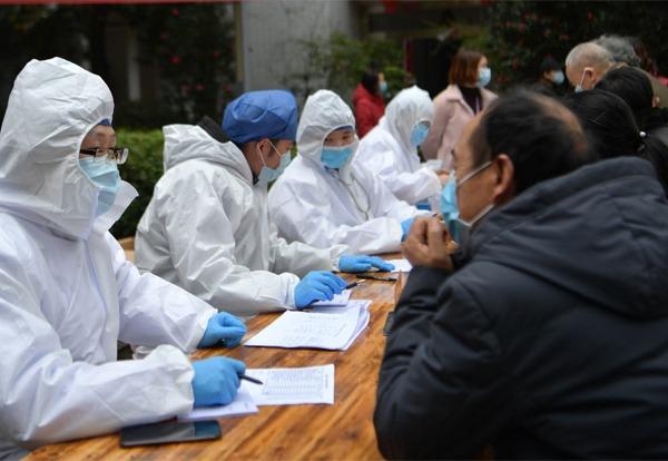 Community workers, doctors keep up coronavirus fight to safeguard Hubei:null