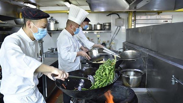 Staff members prepare gourmet food for medics:0