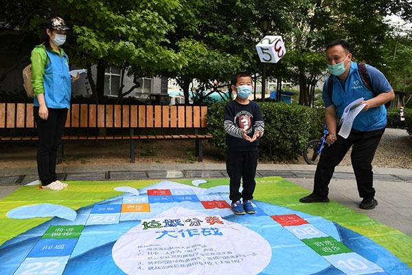 Garbage sorting-themed games help teach in Beijing:null
