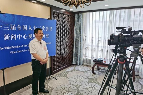 NPC deputies from Hubei receive interview in Beijing:null