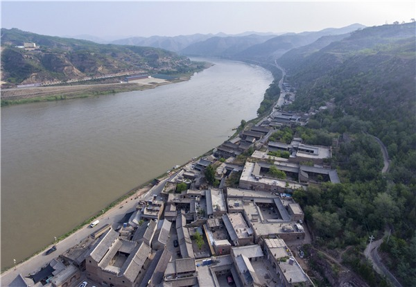Improved environment, booming tourism bring better life to villagers in N China:0