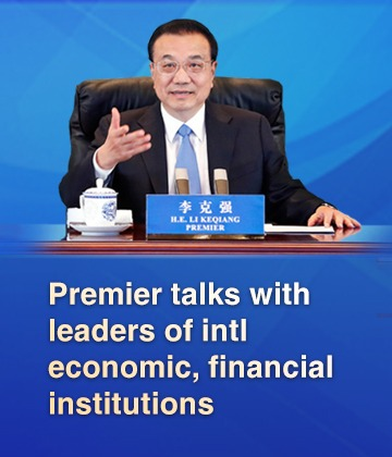 Premier talks with leaders of intl economic, financial institutions