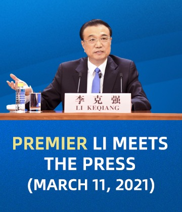 Premier Li meets the press