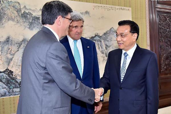 a833d5b9973675 Premier Li Keqiang (R) meets with US Secretary of State John Kerry (C) and  Treasury Secretary Jacob Lew (L) in Beijing